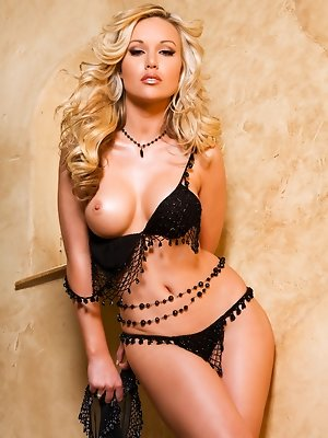 "Kayden Kross definitively epitomizes the term ""blonde bombshell"" in this sexy staircase photo shoot. You won't believe how sensually de"