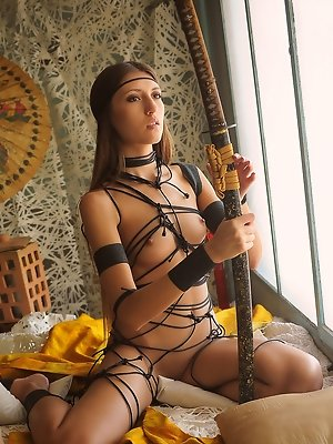 Exotic Saju A is bound by beautiful Shibari bondage  that accentuates her beautiful small breasts and delicate curves.  This captive goddess has her S